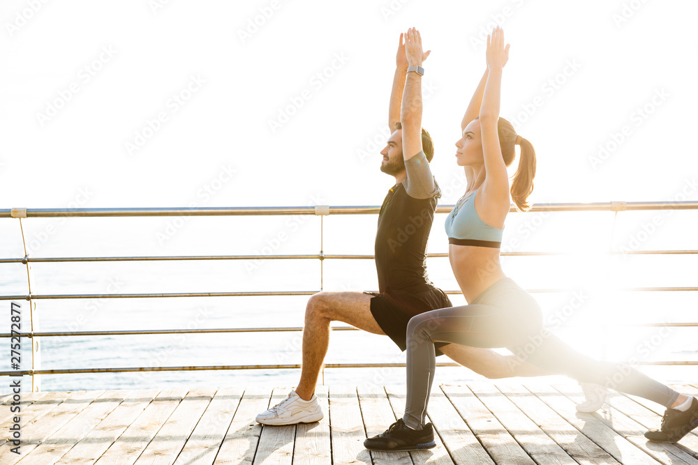 Fototapety, obrazy: Attractive sporty young fitness couple