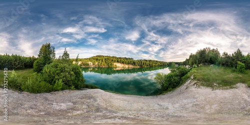 Taupe full seamless spherical hdri panorama 360 degrees angle view on limestone coast of huge green lake or river near forest in summer day with beautiful clouds in equirectangular projection, VR content