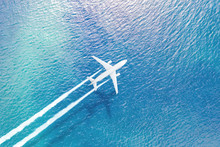 The Plane Flying Over The Sea ...