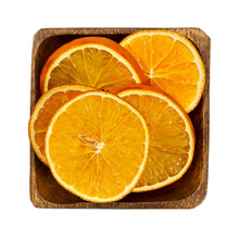 Dried Orange Slices In Wooden Bowl