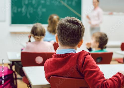 Foto op Canvas Op straat Boy student in elementary school class