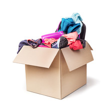 Donation Box With Clothes Isolated On A White Background