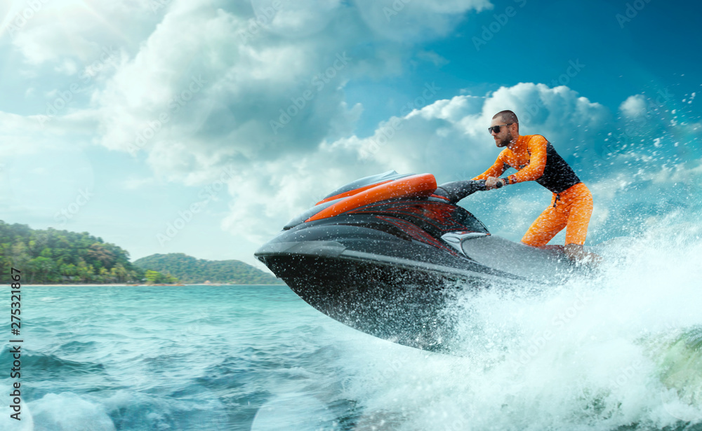 Fototapety, obrazy: Young Man on water scooter, Tropical Ocean, Vacation Concept. Jet Ski. Sea.