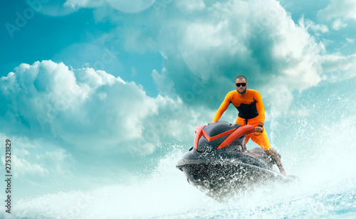 Young Man on water scooter, Tropical Ocean, Vacation Concept Fototapet