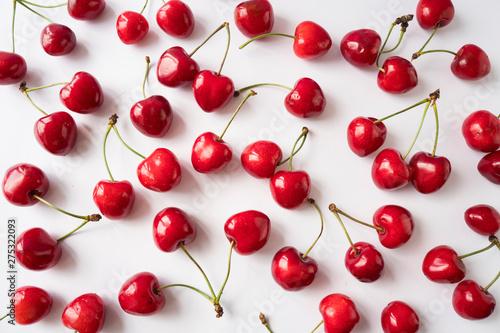Fresh cherries scattered on white  Cherries on a white