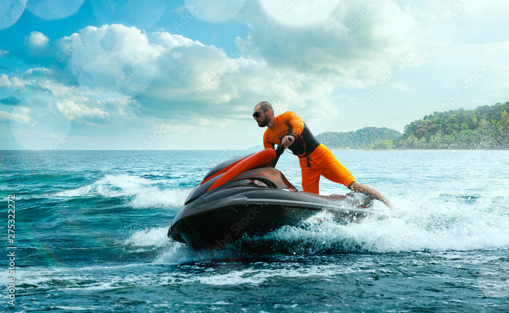 Fototapeta Young Man on water scooter, Tropical Ocean, Vacation Concept. Jet Ski. Sea.