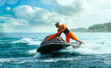 Young Man on water scooter, Tropical Ocean, Vacation Concept. Jet Ski. Sea.