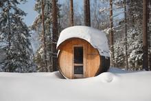 Round Barrel Sauna In The Snow