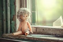 Broken Doll Near The Window In Abandoned School In Pripyat, Chernobyl Alienation Zone