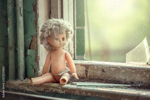 Broken doll near the window in abandoned school in Pripyat, Chernobyl alienation Fotobehang