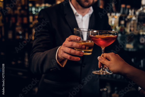 Canvas Print Elegant man and woman are consuming alcohol at the posh restauraunt together