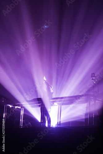 Silhouettes Of Concert Crowd In Front Bright Stage Lights