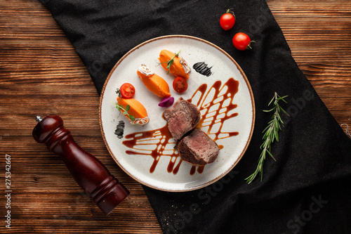 Roasted and sliced in halves filet mignon, served with mashed sweet potatoes and Wallpaper Mural