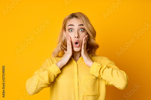 Surprised Woman Holding Hands on her Cheeks Fototapeta
