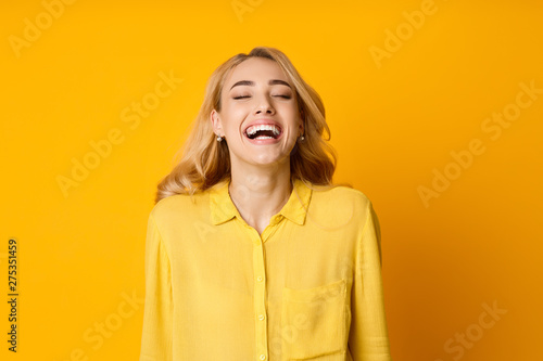 Fotografie, Obraz  Woman Laughing Out Loud, Hearing Funny Joke