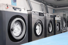 Row Of Modern Washing Machines In Dry-cleaning