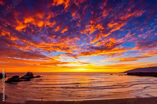 Orange Clouds at Sunset over Beach, Ocean