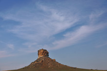 Sandstone Rock Beauty And Fanning Clouds