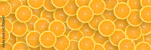 Pattern of orange citrus slices. Citrus flat lay
