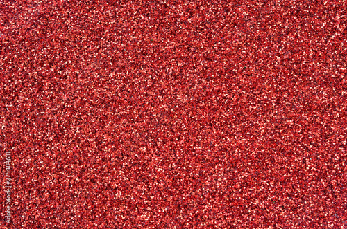 Crimson red decorative sequins. Background image with shiny bokeh lights from small elements - 275384631