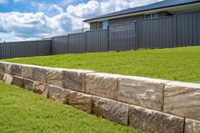 Stone Retaining Wall Backyard Green Grass Fence Neighbour