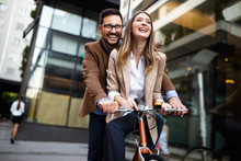 Happy Young Couple Riding On Bicycle. Love, Relationship, Romance Concept.