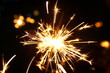 burning sparkler firework. Happy new year and Merry christmas concept. Happy holidays. Abstract blurred of Sparklers for celebration. Magic light. Winter Xmas decoration. Realistic light effect. Party