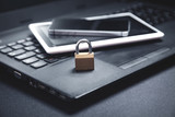 Padlock with laptop, smartphone and tablet. Internet and technology security - 275401045