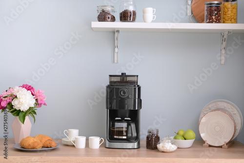 Modern coffee machine in kitchen Fotobehang