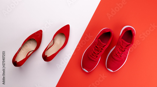 A studio shot of pair of running vs high heel shoes on color background Canvas-taulu