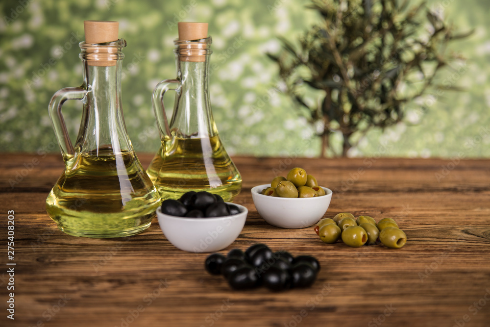 Fototapety, obrazy: Olive oil, olive tree and green and black olives on a wooden table