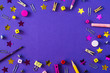 canvas print picture - Multicolored school supplies on violet background with copy space.