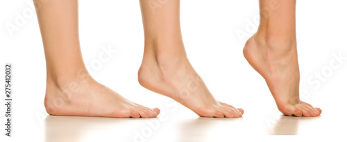 Photo Side view of female bare foot in three different positions on white background