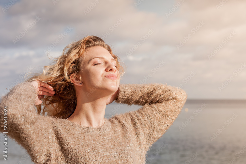 Fototapety, obrazy: Happy woman outdoor wearing jumper