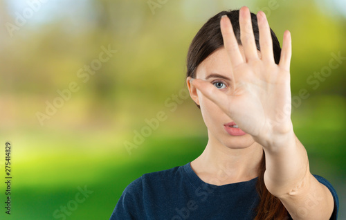 Fotografija  Young woman with disgusted expression repulsing something