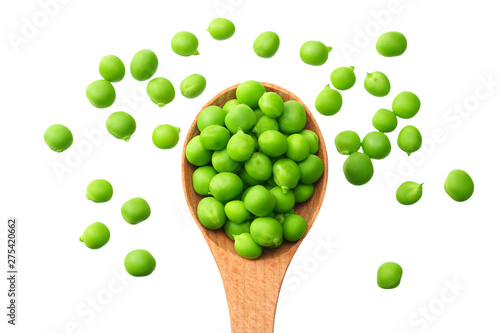 Stampa su Tela fresh green peas in a wooden spoon isolated on a white background