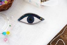 Brooch Handmade Beaded Eyes On Table On White Background