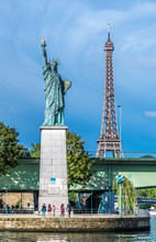 France, 15th Arrondissement Of Paris, Eiffel Tower And Statue Of Libery At The Pont De Grenelle Over The Seine River