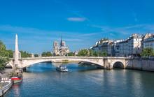 France, 4th Arrondissement Of Paris, Pont De La Tournelle Over The Seine River, Catheral Of Notre-Dame De Paris And Quai D'Orleans On The Ile Saint-Louis
