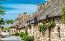 """France, Brittany, Nevez, """"Pays Des Pierres Debout"""" (Land Of The Standing Stones), Street With Tatched Cottage In The Kercanic Village"""