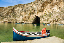 Horizontal View Of Touristic Boat In The Inland Sea -lagoon Of Seawater On The Island Of Gozo Linked To The Mediterranean Sea Through An Opening Formed By A Narrow Natural Arch