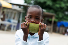 Child Eats A Watermelon With Love In The Street.