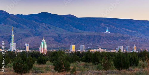 Wednesday, 26 June 2019; Ashgabat, Turkmenistan; Beautiful cityscape, panorama view on the white city at blue mountains with iconic landmarks of the capital of Central Asian state few minutes sunset Wallpaper Mural