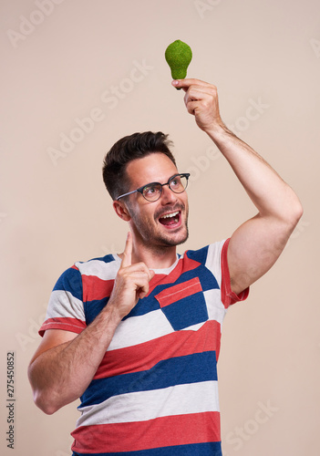 Happy man holding a energy efficient light bulb