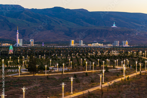 Tuesday, 25 June 2019; Ashgabat, Turkmenistan; Beautiful cityscape, panorama view on the white city at blue mountains with iconic landmarks of the capital of Central Asian state few minutes sunset Wallpaper Mural