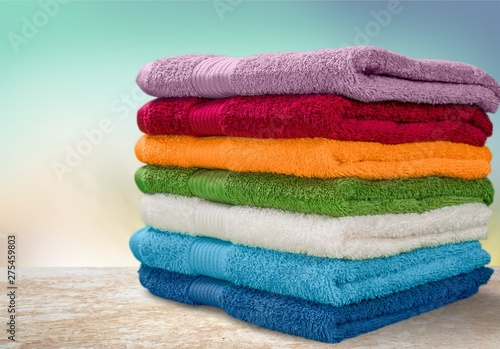 Fotografía Pile of  fluffy towels on background