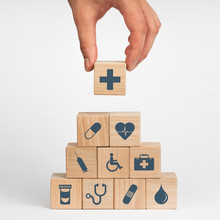 Concept Of Insurance For Your Health, Hand Hold Wooden Block With Icon Healthcare Medical