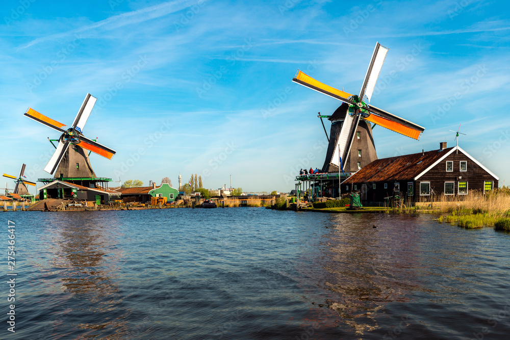 Fototapety, obrazy: Traditional dutch windmills located by the river Zaan, in Zaanse Schans, Netherlands.