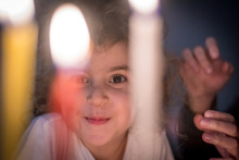 Isolated Close Up Portrait Of A Beautiful Five Year Old Girl Looking At Hanukkah Candles