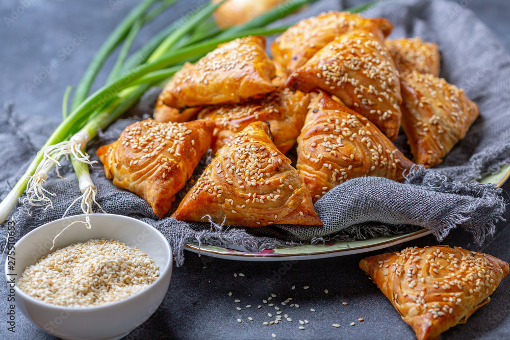 Fototapety, obrazy: Homemade samosas sprinkled with sesame seeds.
